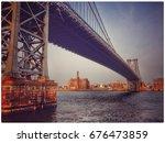 sunset on east river bridge   Shutterstock . vector #676473859