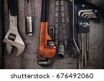 many tools on dirty wall  set... | Shutterstock . vector #676492060