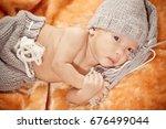 newborn baby lying on fur... | Shutterstock . vector #676499044