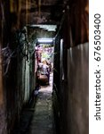 Small photo of Old alley alleyway in the city, selective focus : Bangkok Thailand : July 2017