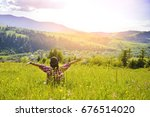 the woman is sitting on the... | Shutterstock . vector #676514020