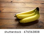 banana on wooden background | Shutterstock . vector #676563808