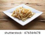 potato chips on plate on wooden ... | Shutterstock . vector #676564678
