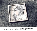Small photo of Slide-puzzle with jumbled map (b&w)