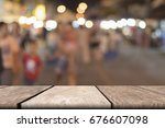 mock up wood table on font and... | Shutterstock . vector #676607098