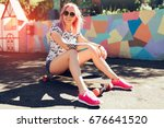 attractive sporty woman with... | Shutterstock . vector #676641520