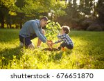 father wearing gray shirt and... | Shutterstock . vector #676651870