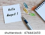 hello august on notebook with... | Shutterstock . vector #676661653