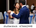 first dance of an attractive... | Shutterstock . vector #676662448