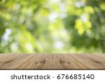wood table top on nature green... | Shutterstock . vector #676685140
