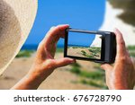 woman taking picture of cliff... | Shutterstock . vector #676728790