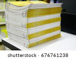 stack of yellow book on table | Shutterstock . vector #676761238