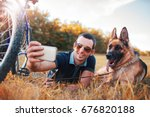 young dog owner enjoying in the ... | Shutterstock . vector #676820188