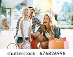 happy family with shopping bags ... | Shutterstock . vector #676826998