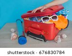young woman packing suitcase.... | Shutterstock . vector #676830784
