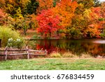 Fall Scene With Fence And Lake