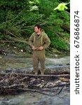 Small photo of KODORI GORGE, ABKHAZIA - JUNE 18, 2017: Abkhazian hunter at the forest