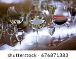 table with alcohol poured into... | Shutterstock . vector #676871383