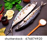 two mackerel in spices on a... | Shutterstock . vector #676874920