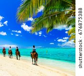 horse riding on tropical beach. ... | Shutterstock . vector #676875388
