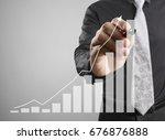 businessman drawing graphics a... | Shutterstock . vector #676876888