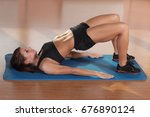 young woman holds training.... | Shutterstock . vector #676890124