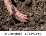 old grandfather planting seeds... | Shutterstock . vector #676891960