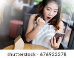 asian girl with happiness... | Shutterstock . vector #676922278