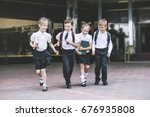 beautiful school children... | Shutterstock . vector #676935808