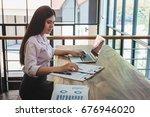 business woman accountant... | Shutterstock . vector #676946020