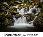 Blurred Waterfall Through Moss...