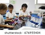 diverse kindergarten students... | Shutterstock . vector #676955404