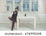 man sitting on wooden chair at... | Shutterstock . vector #676990348