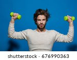 handsome man with barbell or... | Shutterstock . vector #676990363