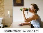 woman getting having her green... | Shutterstock . vector #677014174
