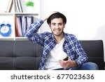 young man at office with mobile ... | Shutterstock . vector #677023636