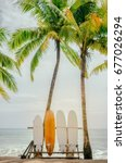 surfboard and palm tree on... | Shutterstock . vector #677026294
