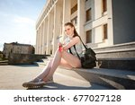 young beautiful stylishly... | Shutterstock . vector #677027128