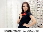 woman holding her glasses in... | Shutterstock . vector #677052040