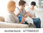 asian grandparent playing music ... | Shutterstock . vector #677060323