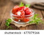 filled pimientos on an old... | Shutterstock . vector #677079166