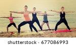 joyful sporty women practicing...   Shutterstock . vector #677086993