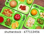 Stock photo serving trays with delicious food on table concept of school lunch 677113456