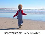 a young boy is running towards... | Shutterstock . vector #677136394