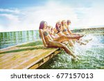 group of happy young woman feet ... | Shutterstock . vector #677157013