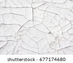 old cracked white painted... | Shutterstock . vector #677174680