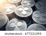 ripple coins  xrp  in blurry... | Shutterstock . vector #677221393
