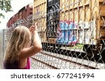 Young Girl Watching A Train...