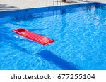 red inflatable lilo lounger... | Shutterstock . vector #677255104