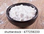 tapioca flour into a bowl over...   Shutterstock . vector #677258233